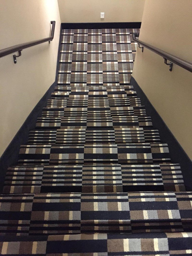 design fail of a staircase covered in a trippy carpet