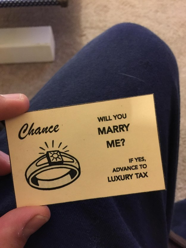 Man proposes with a custom board of monopoly.