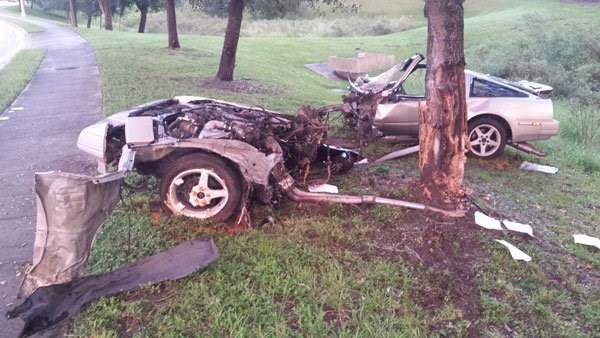 Crash split car in half and man survives with no life threatening injuries.