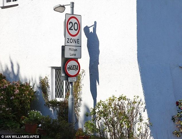 A shadow creates an optical illusion of a hange