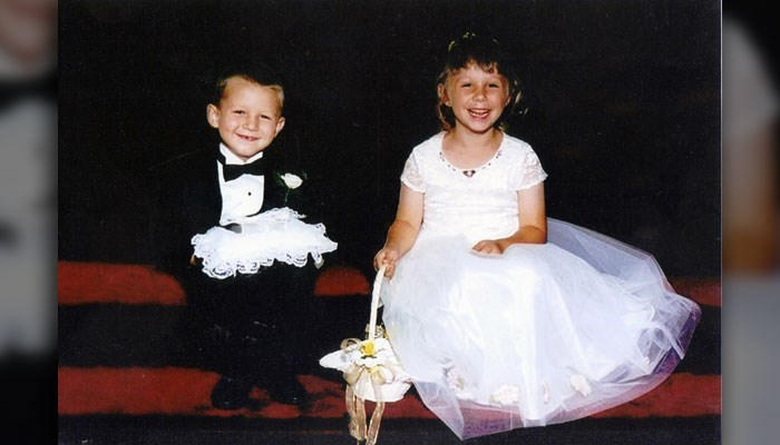 17 years later, the ring bearer and the flower girl get married.