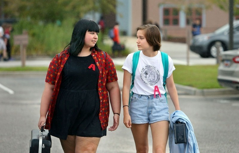High school girls wear the scarlet letter to protest a dress code.