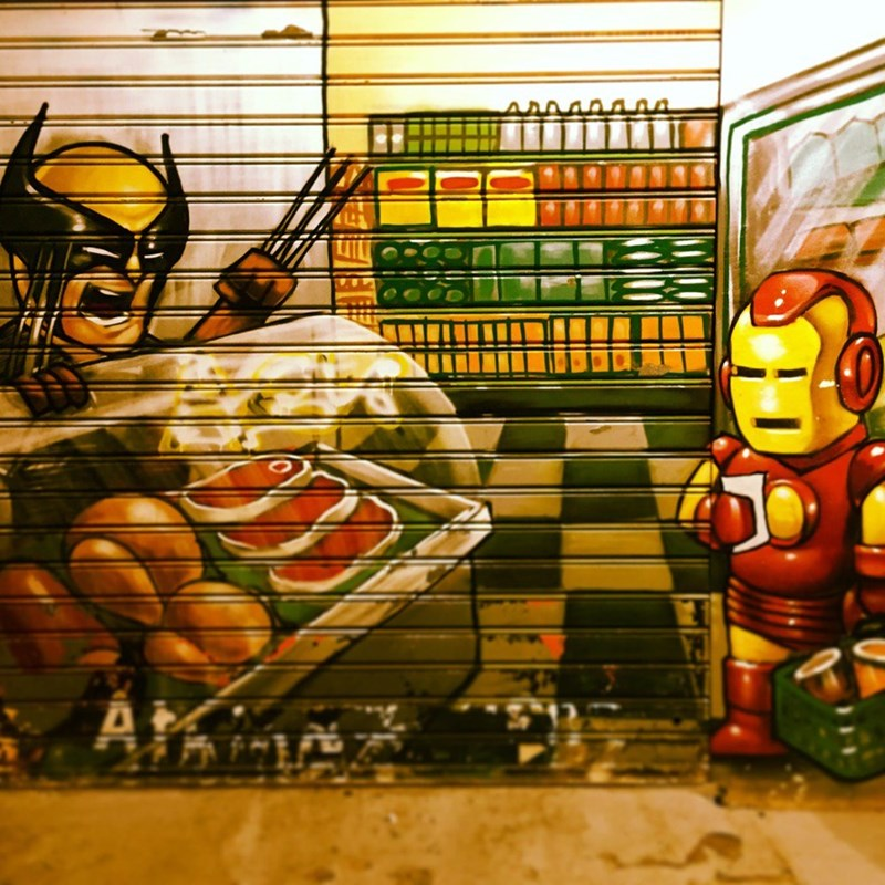 wolverine iron man Superhero's Go Shopping in This Graffiti Masterpiece