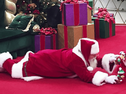 christmas santa autism Mall Santa Shows Us What Christmas is Really About by Laying on the Floor to Talk to a Boy With Autism