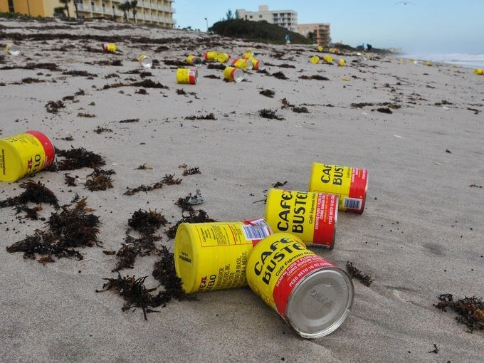 thousands of coffee cans wash ashore florida