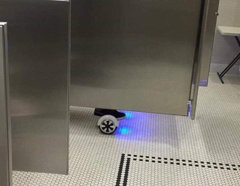 funny bathroom image hoverboard over the toilet
