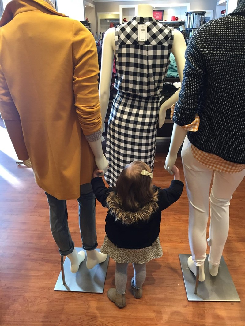 funny parenting image little girl befriends mannequins
