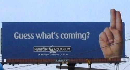 guess whats coming aquarium sign