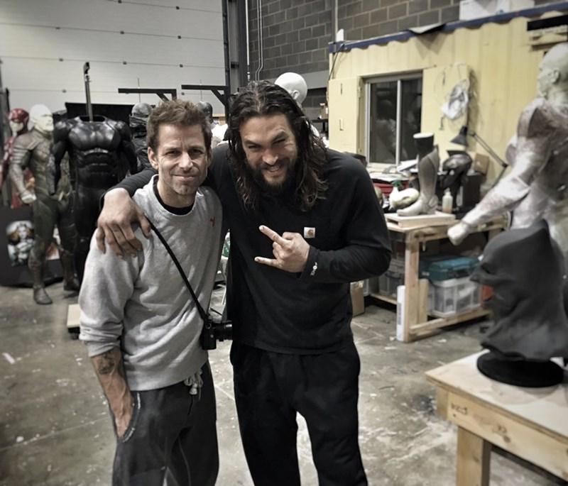 justice league Zach Snyder Teases Justice League Costumes in the Background of a Picture With Jason Momoa