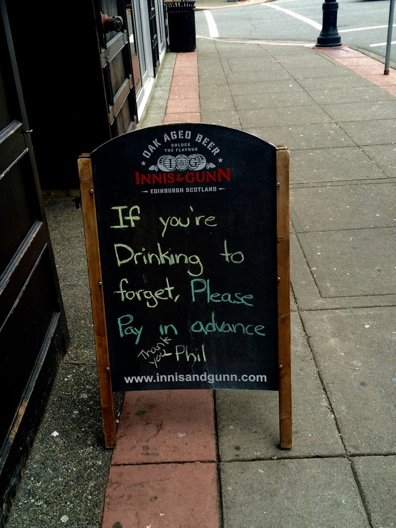 funny sign drinking to forget