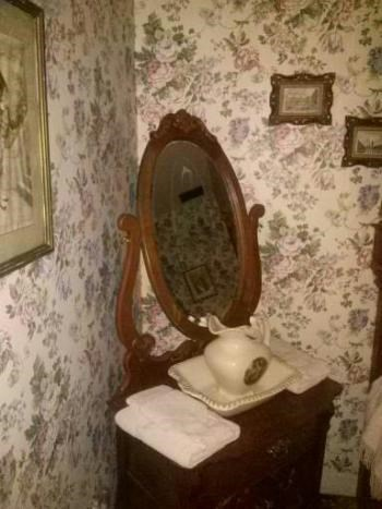 lizzie borden image ghosts An Artist Claims to Have Captured a Photo of a Ghost in the Mirror of Lizzie Borden's House