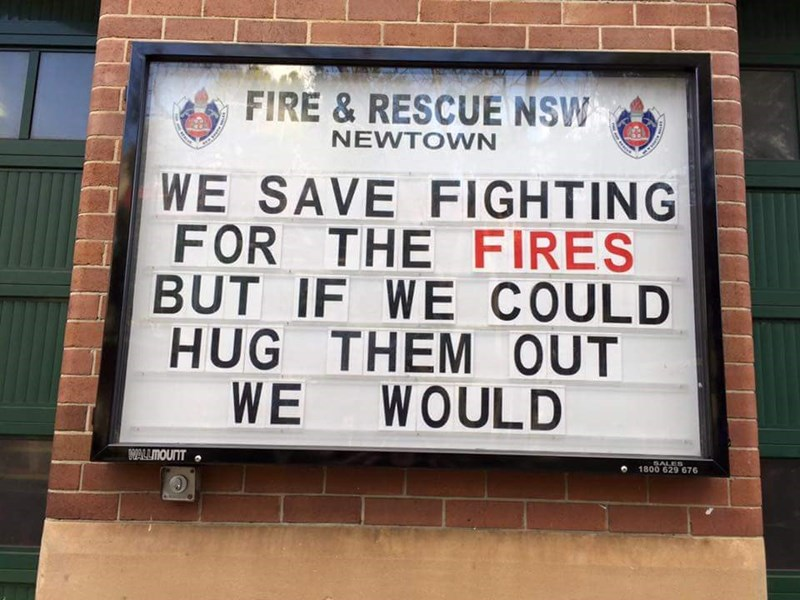 Text - FIRE & RESCUE NSW NEWTOWN WE SAVE FIGHTING FOR THE FIRES BUT IF WE COULD HUG THEM OUT WE WOULD WALLIMOUNT SALES 1800 629 676