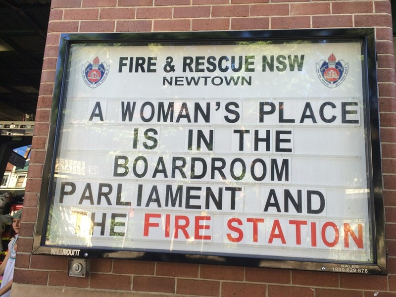 Text - FIRE & RESCUE NSW NEWTOWN DOVTE A WOMAN'S PLACE IS IN THE BOARDROOM PARLIAMENT AND HE FIRE STATION WALLMOUT SALES 1800 629 676 SOUTH
