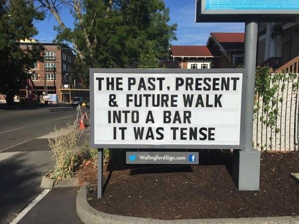 Street sign - THE PAST, PRESENT & FUTURE WALK INTO A BAR IT WAS TENSE WallingfordSign.com f