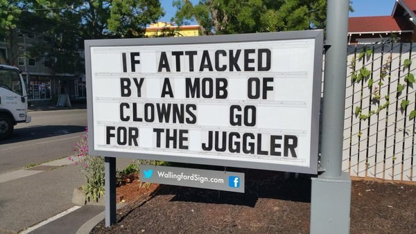 Street sign - IF ATTACKED BY A MOB OF CLOWNS GO FOR THE JUGGLER WallingfordSign.comf