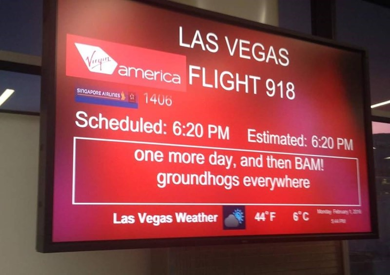 boarding sign - Display device - LAS VEGAS Vey'a america FLIGHT 918 SINDAPORE AIRLINES 1406 Scheduled: 6:20 PM Estimated: 6.20 PM one more day,and then BAM! groundhogs everywhere 44 F C s S4 Las Vegas Weather