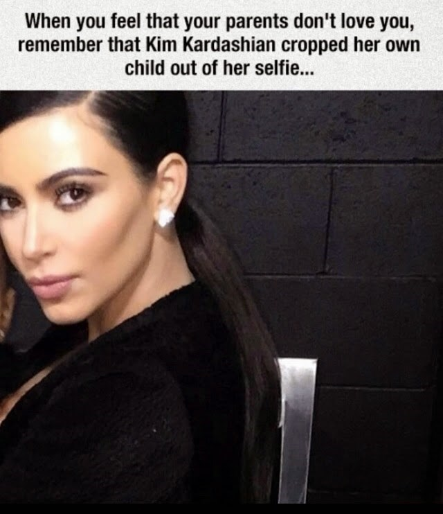 kim kardashian crops daughter out of selfie