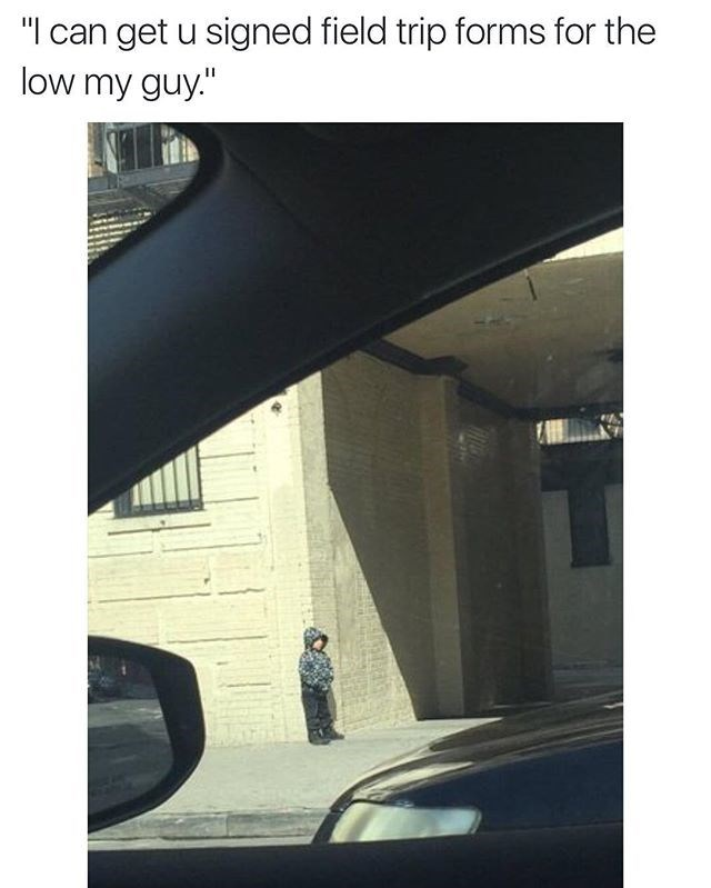 kid chills on corner to sign field trip papers