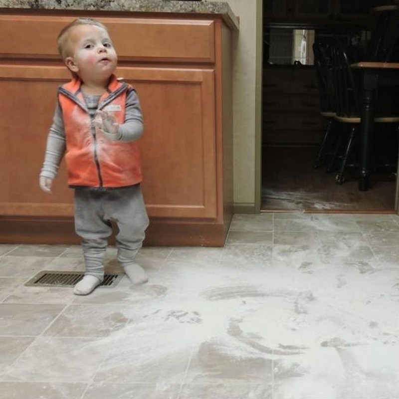 baby gets caught in the kitchen with extreme mess