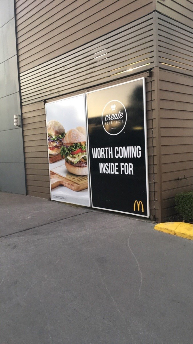 funny fail image McDonald's new hamburger sign is sexually suggestive