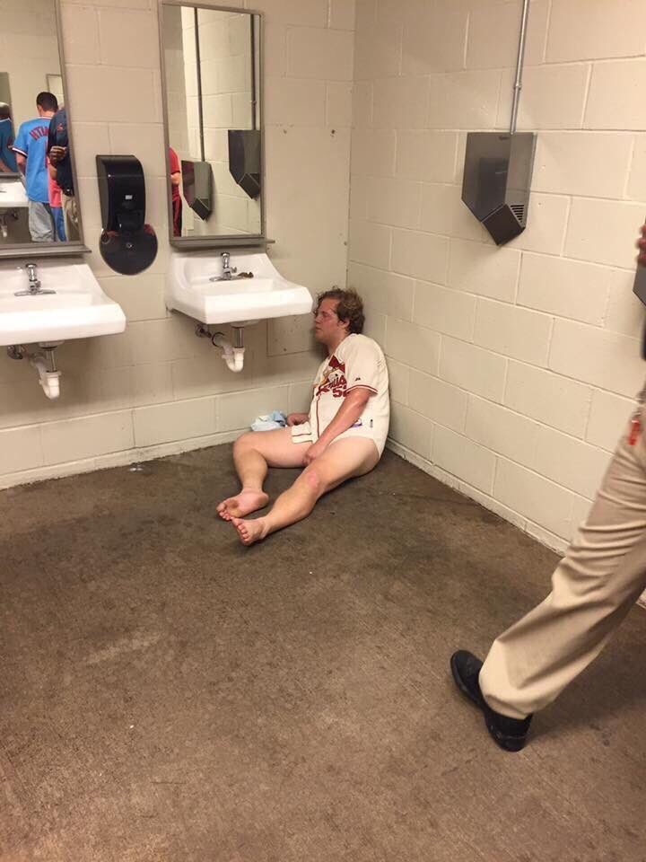 fail image sports fan ends up passed out drunk and pantless in stadium bathroom