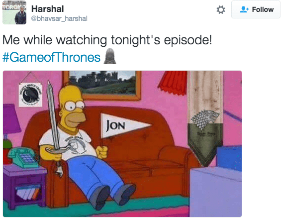 tweet about game of thrones picture homer simpson watching tv holding flag that says jon Me while watching tonight's episode!