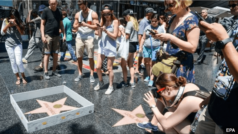"Donald Trump's call for a ""great, great wall"" has been answered with a tiny, tiny one. It keeps people out - from stepping on his star on the Hollywood Walk of Fame!"