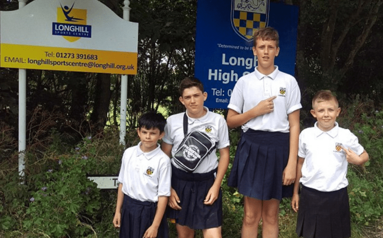 Despite the sweltering heat, the school boys of Longhill High School in Brighton, East Sussex, were still forced to comply with the dress code and wear long trousers. Some came to school in their school's gym shorts, but that did not fly.  A few enterprising boys found a clever loophole: the skirts that are part of the school's dress code for girls