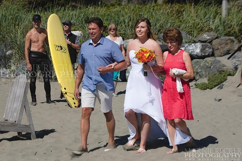 Canadian Prime Minister Trudeau was leaving the beach as a bride-to-be was coming down the stairs. With his wetsuit pulled down to his waist, he photobombed with his bare torso.