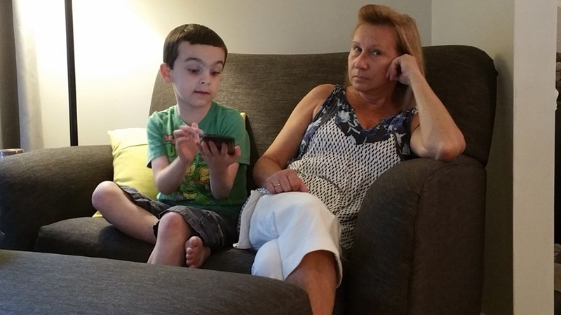 funny parenting image woman is not interested in Pokémon GO explanation by nephew
