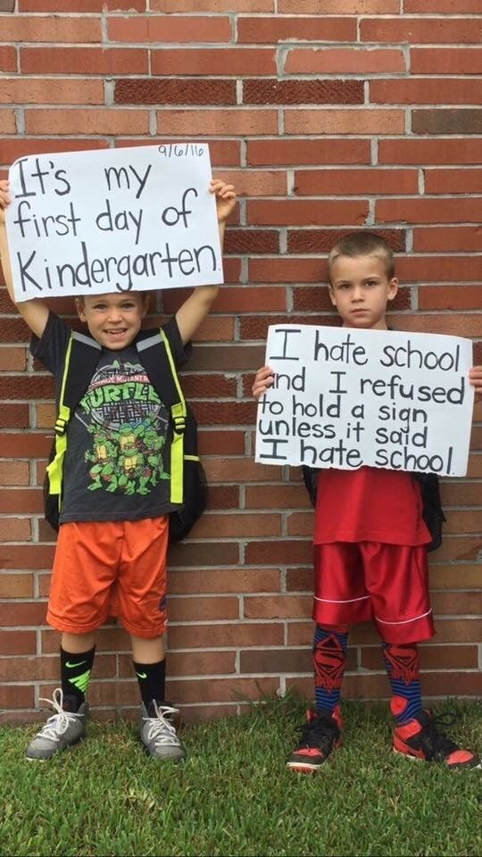 win image kids hold up brutally honest back to school sign