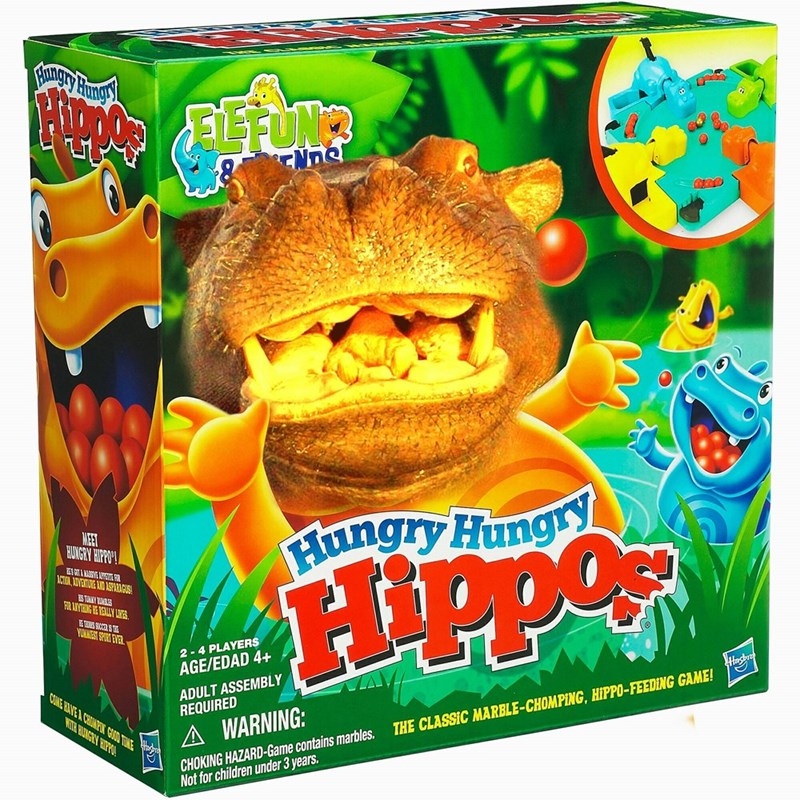 Toy - Hung ENne Fiangry Hung y MEET HUNGRY HIPPO CVENTURE AID ASPARIGUS FAR ANVTEHING HE REALLY LANES. YORKNEST SPORT EVER 2-4 PLAYERS Hasdra AGE/EDAD 4+ ADULT ASSEMBLY REQUIRED CONE HAVE A CHIMPON GOOD TIME WTH BUNGRY HIPPO A WARNING: THE CLASSIC MARBLE-CHOMPING, HIPPO-FEEDING GAME! CHOKING HAZARD-Game contains marbles. Not for children under 3 years