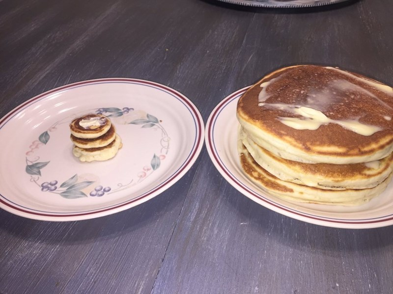 Dish with regular pancakes and the tiny cute pancakes for the cat