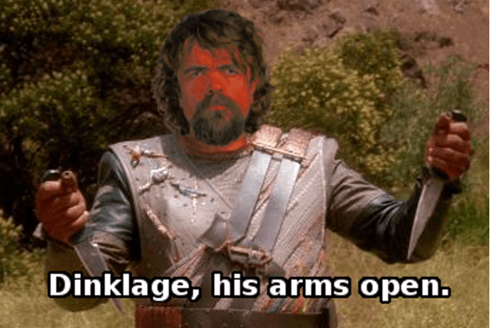 Photo caption - Dinklage, his arms open.