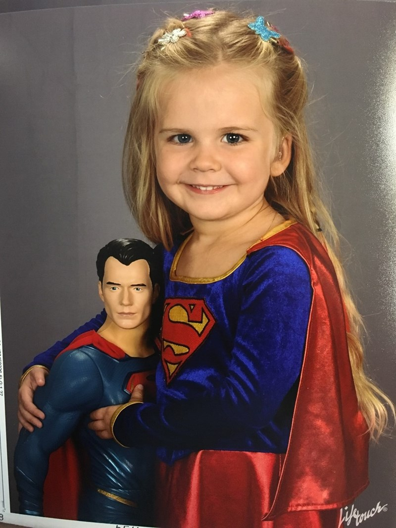 cute parenting win She's the Superhero Picture Day Deserves
