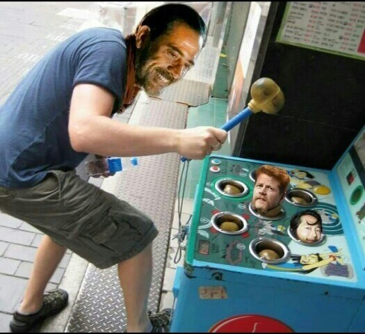 Funny The Walking Dead meme of Negan playing Whack-A-Mole with the character's he killed.