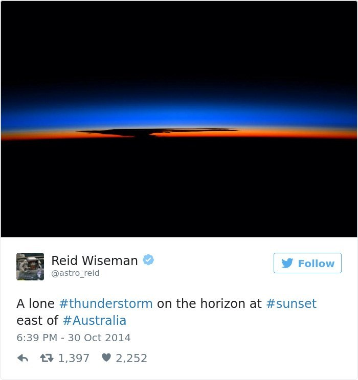 Text - Reid Wiseman Follow @astro_reid A lone #thunderstorm on the horizon at #sunset east of #Australia 6:39 PM 30 Oct 2014 t1,397 2,252