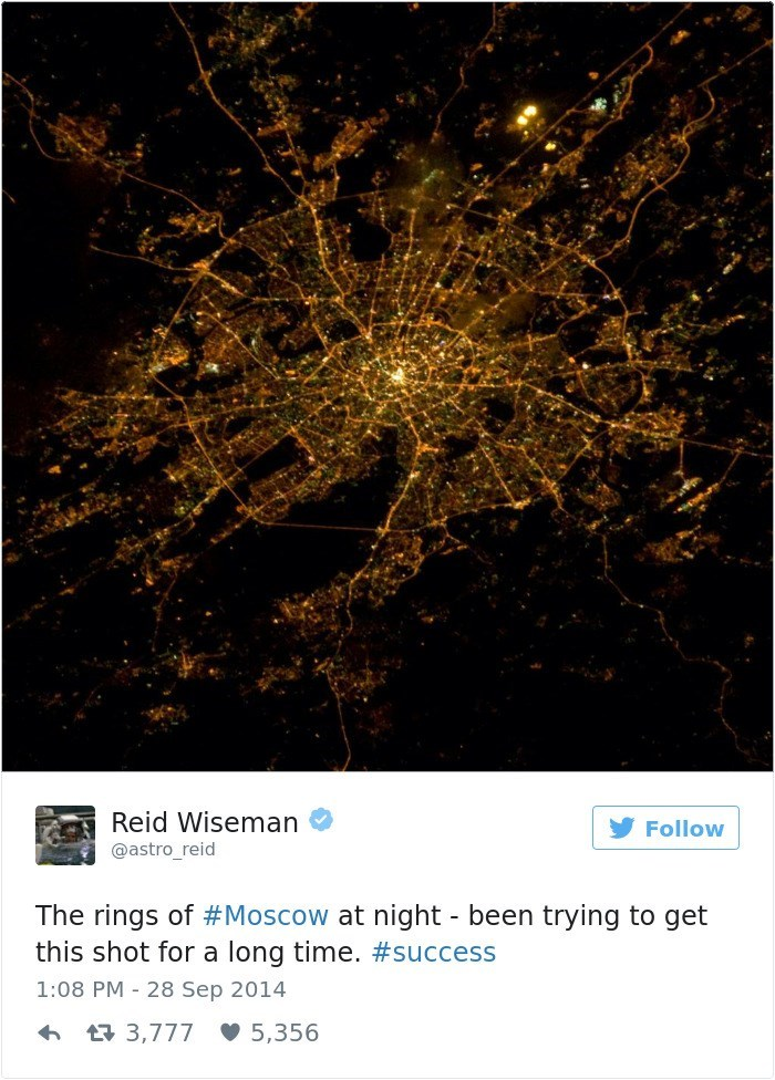 Text - Reid Wiseman Follow @astro_reid The rings of #Moscow at night - been trying to get this shot for a long time. #success 1:08 PM 28 Sep 2014 3,777 5,356