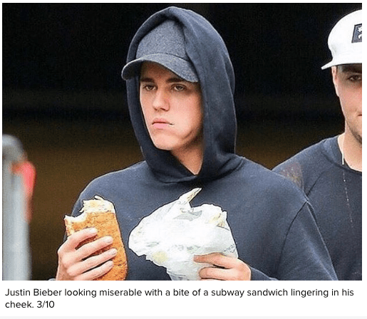 Cap - Justin Bieber looking miserable with a bite of a subway sandwich lingering in his cheek. 3/10 31