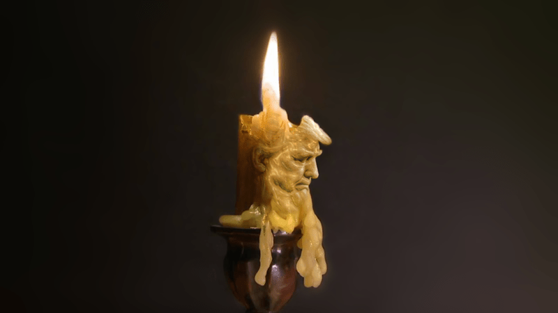 Trump burning candle with double chin
