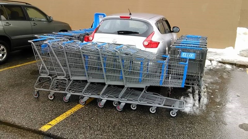 bad parker blocked in by barricade of shopping carts