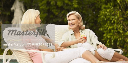 two older women lounging outside