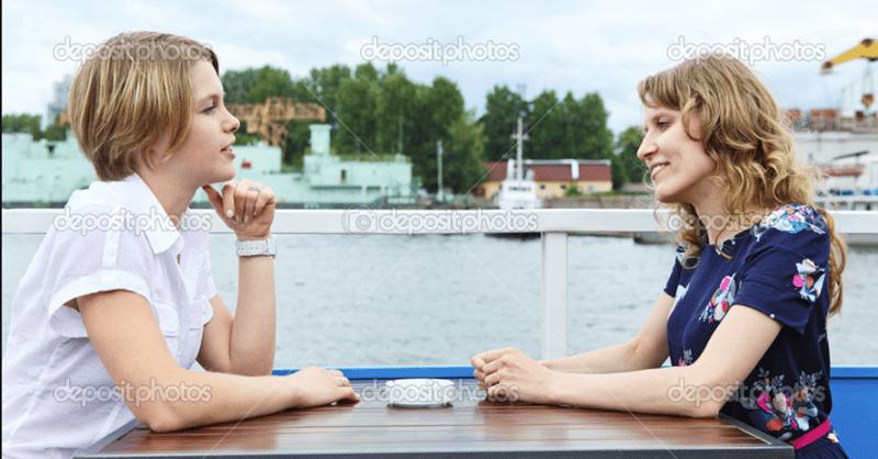 man and boy sitting near a river