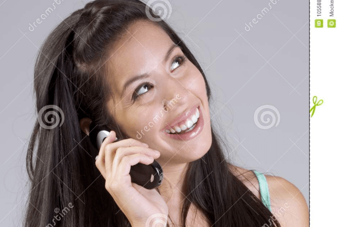 girl talking on a phone and smiling