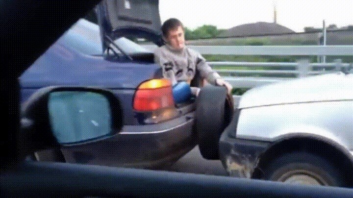 gif of man holding tire as bumper