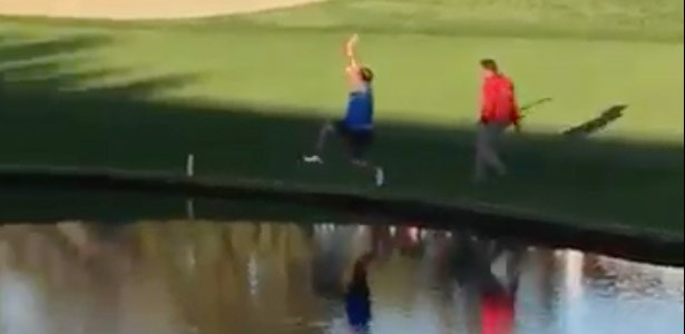 fail video guy jumps in pond at golf course