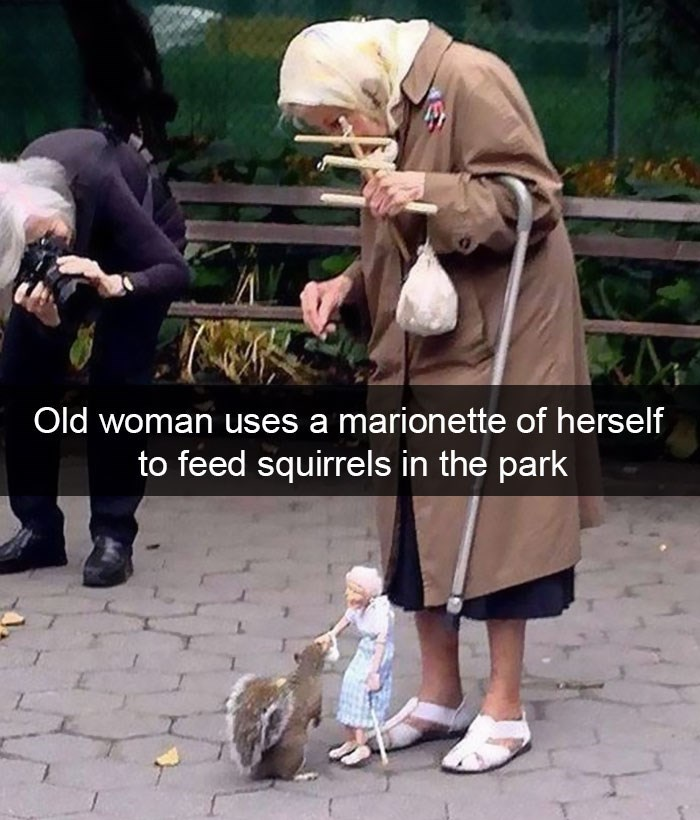 snapchat - Street performance - Old woman uses a marionette of herself to feed squirrels in the park