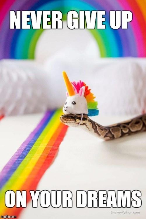 happy meme of a snake wearing a unicorn mask