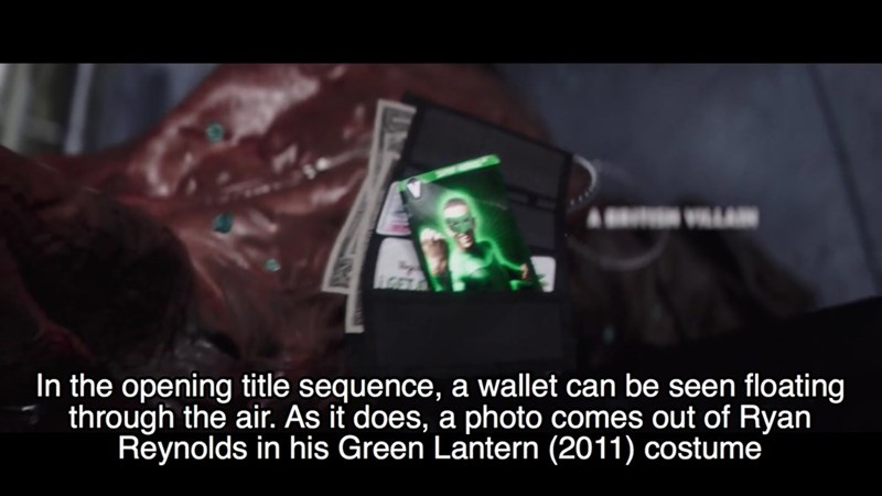 Text - A In the opening title sequence, a wallet can be seen floating through the air. As it does, a photo comes out of Ryan Reynolds in his Green Lantern (2011) costume