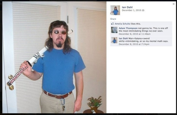 cringey pic of an intimidating guy with a mullet and sunglasses posing with a katana sword